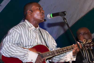 "Adrian ""the Docl"" Martinez with Andy Palacio and the Garifuna Collective performing live at Y-Not Island in Dangriga, Stann Creek, Belize."