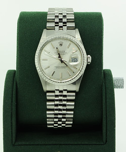 This (Pre-Owned) DateJust Rolex is timeless! Ask any collector & this is one that is truly loved! With a stainless steel body & illuminating numerals, it's not only great for men but women can rock this model just as well!