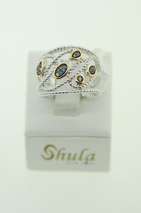 Fun & unique is the best way to describe this ring by Shula! It's in sterling silver with a splash of gold & a few sapphires! Check out it's matching bracelet as well!