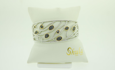 You'll have fun wearing this hand made bracelet by Shula! Being a sterling silver cuff, it's easy to fit to fit to any wrist. We are loving the 14K gold & sapphire accents! Be sure to check out the matching ring!
