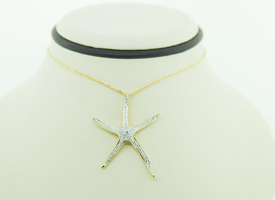 This Shula Starfish Necklace is a show-stopper! Hand designed, 14k chain & setting & as unique as the person that wears it!