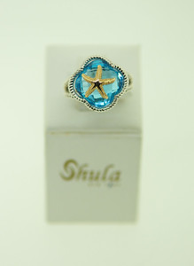 How fun is this starfish Shula ring?! Set in sterling silver with a turquoise center stone, topped with a 14k gold starfish, it's sure to be an accent piece to wear all year long!