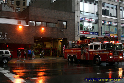 NYFD Engine 54, Ladder 4, Battalion 9 located on 8th Avenue at 48th Street. This was a few hours before Hurricane Irene hit, August 27, 2011