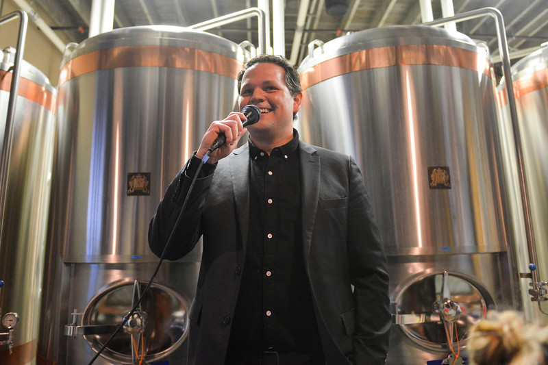 Justin Sheely | The Sheridan Press<br /> <br /> Executive director of Sheridan Travel and Tourism Shawn Parker speaks to the crowd gathered during the Project Enterprise announcement at Black Tooth Brewing Company Tuesday, Jan. 23, 2018. Adam Weatherby announced via Facebook Live plans to move his family's well-known firearms manufacturer to Sheridan, adding an additional 65-90 jobs to the community over the next several years.