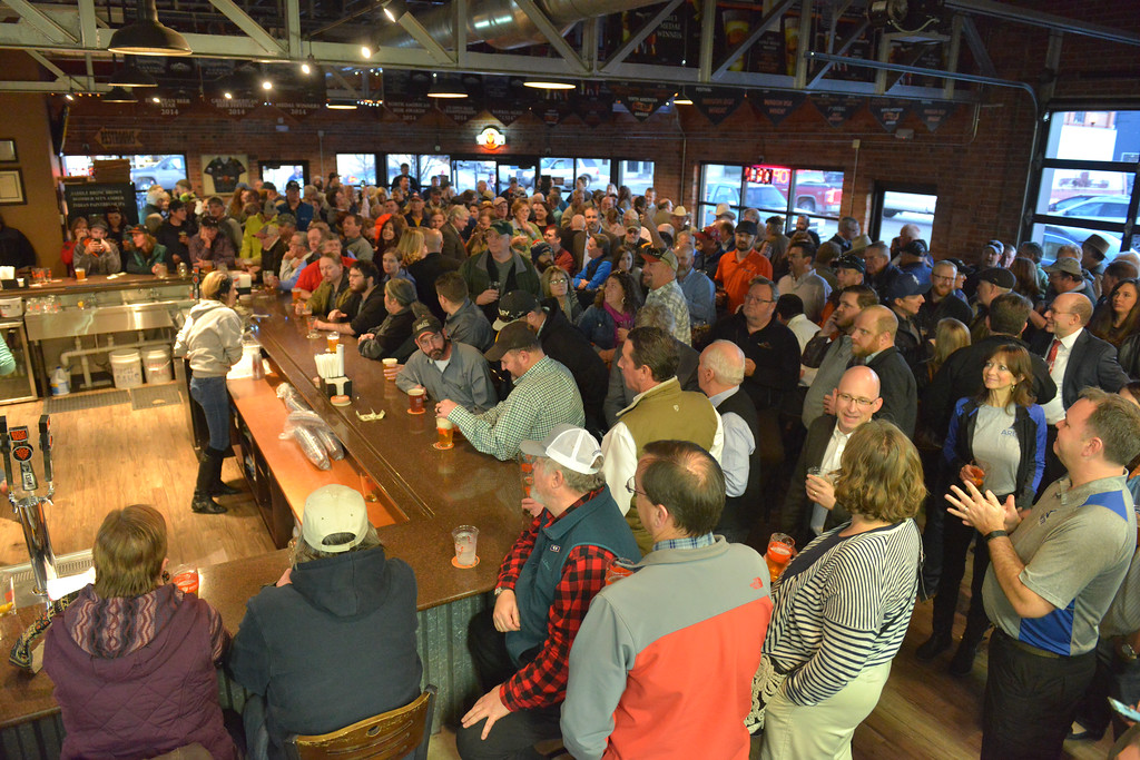 Justin Sheely | The Sheridan Press<br /> <br /> People gather around the bar during the Project Enterprise announcement at Black Tooth Brewing Company Tuesday, Jan. 23, 2018. Adam Weatherby announced via Facebook Live plans to move his family's well-known firearms manufacturer to Sheridan, adding an additional 65-90 jobs to the community over the next several years.