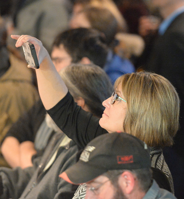Justin Sheely | The Sheridan Press<br /> <br /> Sheridan County Chamber of Commerce executive director Dixie Johnson records on her smartphone during the Project Enterprise announcement at Black Tooth Brewing Company Tuesday, Jan. 23, 2018. Adam Weatherby announced via Facebook Live plans to move his family's well-known firearms manufacturer to Sheridan, adding an additional 65-90 jobs to the community over the next several years.
