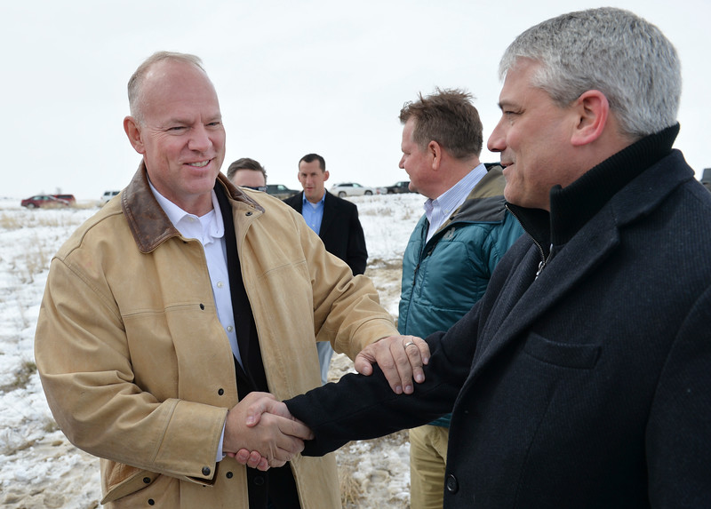 Justin Sheely | The Sheridan Press<br /> Wyoming Governor Matt Mead, left, shakes hands with Sheridan Mayor Roger Miller during the groundbreaking ceremony at the Weatherby site at High Tech Park in north Sheridan Friday, April 6, 2018.