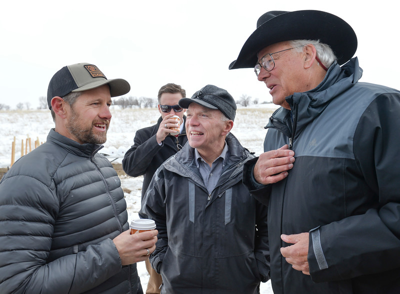 Justin Sheely | The Sheridan Press<br /> Adam Weatherby, left, visits with Rep. Mark Kinner, center, and Wyoming Business Council co chair Pete Illoway during the groundbreaking ceremony at the Weatherby site at High Tech Park in north Sheridan Friday, April 6, 2018.