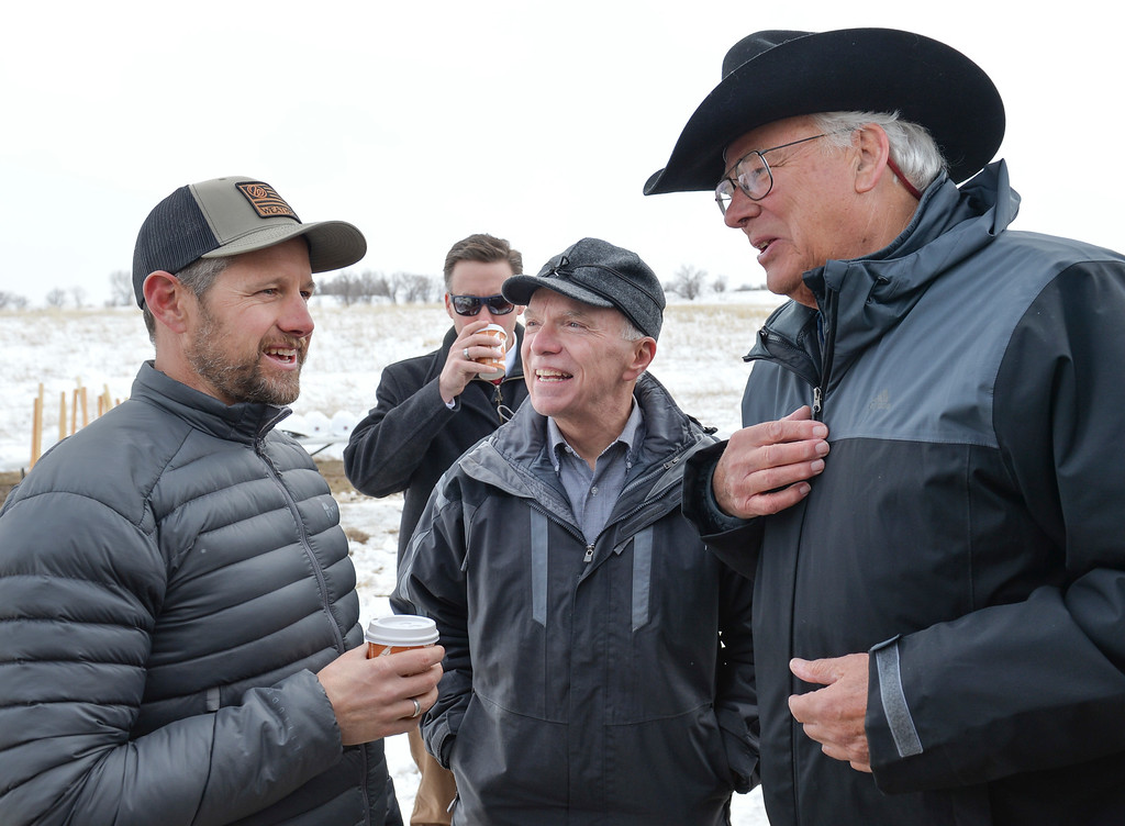 Justin Sheely   The Sheridan Press<br /> Adam Weatherby, left, visits with Rep. Mark Kinner, center, and Wyoming Business Council co chair Pete Illoway during the groundbreaking ceremony at the Weatherby site at High Tech Park in north Sheridan Friday, April 6, 2018.