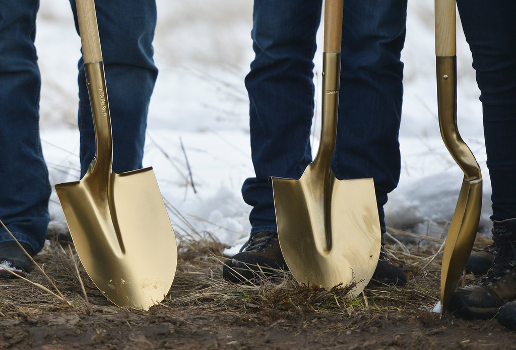 Justin Sheely   The Sheridan Press<br /> Officials grab ceremonial shovels during the groundbreaking ceremony at the Weatherby site at High Tech Park in north Sheridan Friday, April 6, 2018.