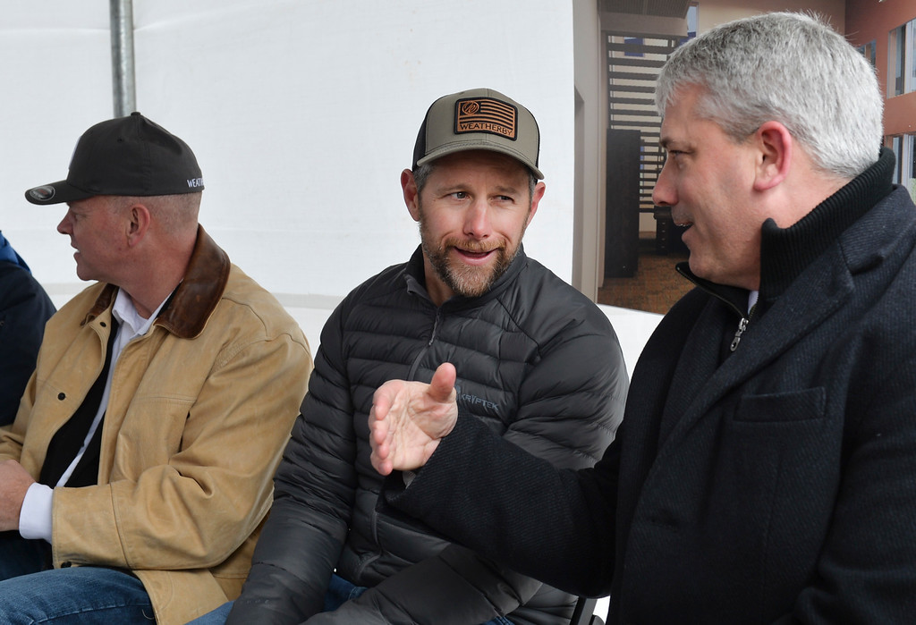 Justin Sheely   The Sheridan Press<br /> Adam Weatherby, left, visits with Mayor Roger Miller during the groundbreaking ceremony at the Weatherby site at High Tech Park in north Sheridan Friday, April 6, 2018.