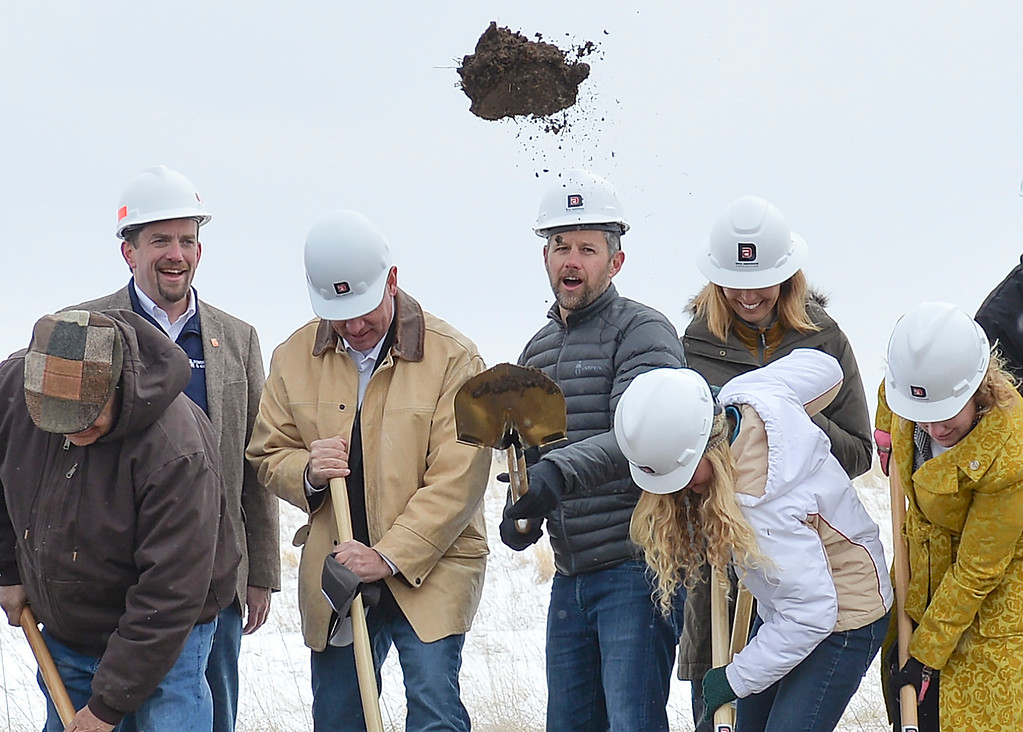 Justin Sheely   The Sheridan Press<br /> Weatherby president Adam Weatherby, center, turns earth during the groundbreaking ceremony at the Weatherby site at High Tech Park in north Sheridan Friday, April 6, 2018. Pictured, from left, Tom Kinnison Ken Thorpe, Wyoming Governor Matt Mead, Adam Weatherby, Brenda Weatherby, Dana Weatherby, and Wyoming Superintendent of Public Instruction Jillian Ballow.