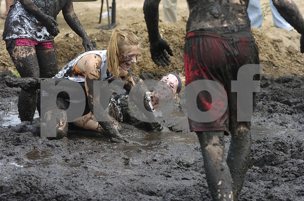 -Messenger photo by Hans Madsen<br /> <br /> Zoe Schneider, 16, with the Shutterbug 4-H Club, left, and Hannah Lentsch, 17, with the Johnson Jaguars, end up in a muddy heap Saturday morning while competing in the annual mud volleyball game at the Webster County Fair.