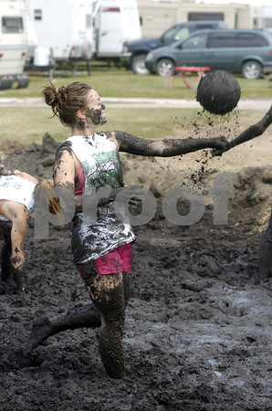 -Messenger photo by Hans Madsen<br /> <br /> Ashley Edge, 17, with the Douglas Dreamers 4-H Club, demonstrates one of the difficulties encounterd when playing mud volley ball - the ball gets coated with the messy goo and becomes much heavier than regulation. It also sprays everywhere when it's struck.