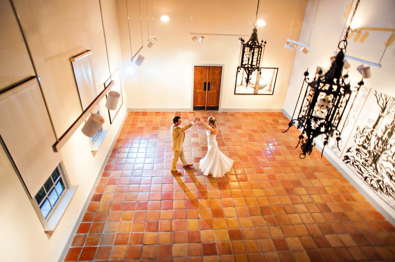Bride and groom dance in gallery space in Crisp-Ellert Art Museum.
