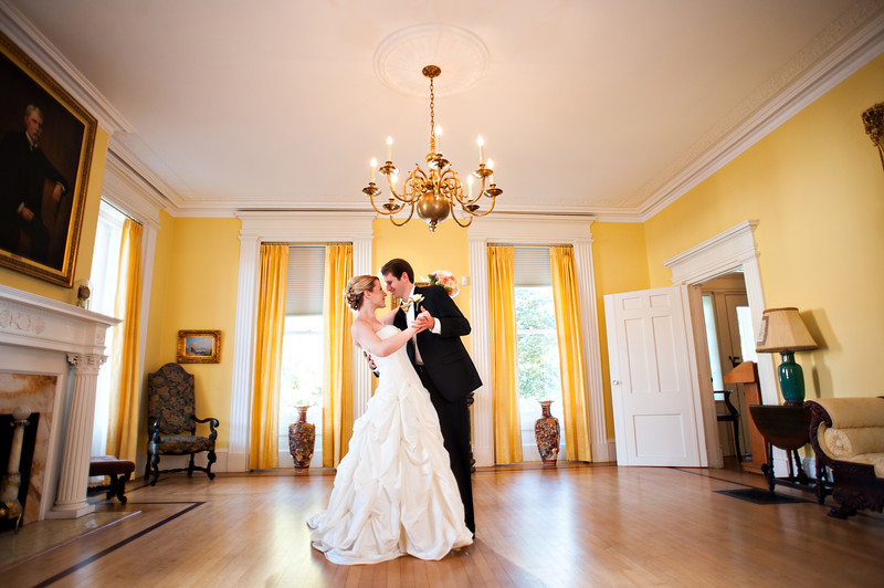 """Bride and groom dance in Markland House's """"Yellow Room."""""""
