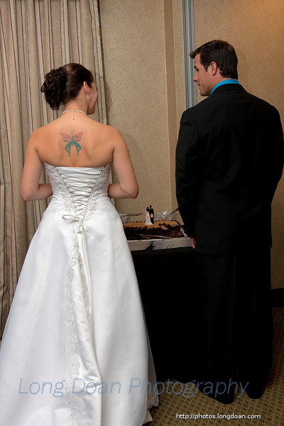 Admiring the cake topper.