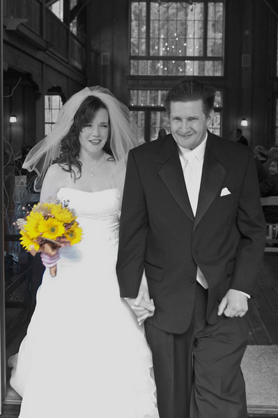 The bride and groom leaving the ceremony at Nestldown.  One of my favorite editing tools is to focus one object in color and have the rest of the image in black and white.  For me, flowers are an easy focal point for this technique.