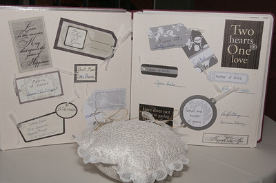 The couple's guestbook and ringbear pillow.