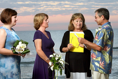 101010 - OCEAN RIDGE - After 21 years together as a couple, Ocean Ridge residents Debby and Joseph Belmonte, tied the knot during sunrise on 10-10-10. (L to R)  Jamie Sladky (Debby's daughter), Debby Belmonte, Mya Bremen, and Jopeph Belmonte.  Joseph is pictured reading his vows to Debby. photo by Tim Stepien