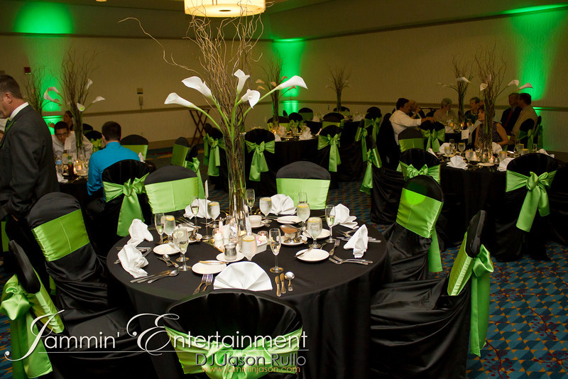 Green uplighting to match the room's decor.