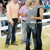 Don Knight | The Herald Bulletin<br /> Savannah Martin, left, hugs fellow competitor Faith Kitts after being named this year's Supreme Showman at the 4-H Fair on Wednesday. Looking on from left are competitors Drew Johnson and Miller Smith.