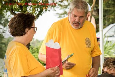 Cindy and Rick Harcharik receiving a gift of appreciation