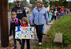 Becca Organek, left, and Kiera Drissel head to West Broad Street Elementary School with fellow students and family members.  (The Reporter/Geoff Patton)