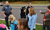 Walkers wave to  mascot  Willie B. Smart as they arrive at West Broad Street Elementary School on Walk to School Day.   At left is Franconia Township police officer Kurt Deforrest.    (The Reporter/Geoff Patton)