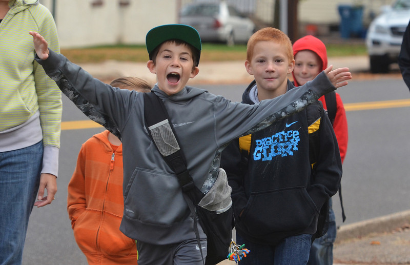 Youngsters  make their way to West Broad Street Elementary School on Walk to School Day.  Wednesday, October 9, 2013.   (The Reporter/Geoff Patton)