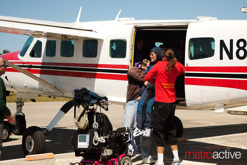 Kameda is lifted into the plane.<br /> <br /> Photo by Jessica Shirley-Donnelly, JRSD Photography