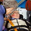 "San Jose resident Gloria Hale is diagnosed with Amyotrophic Lateral Sclerosis (ALS). More commonly known as Lou Gehrig's Disease, ALS is a terminal illness that affects the motor neurons, gradually robbing the body of its ability to independently move, speak, eat, or breathe. Dependent upon a wheelchair for mobility, Hale has lost much of her body's movement and speech.<br /> <br /> There is no effective treatment for ALS. There is no cure.<br /> <br /> In an effort to raise awareness of this disease -- as well as funds for ALS Therapy Development Institute -- Hale organized a skydiving fundraiser, jumping from an airplane 13,000 feet in the sky along with fellow Bay Area ALS patient Juri Kameda and eight of their friends and family.<br /> <br /> Here, Hale prepares for her jump, suited up and surrounded by friends and family. Written on her face in red is ""KISS MY ALS.""<br /> <br /> Photo by Jessica Shirley-Donnelly, JRSD Photography"