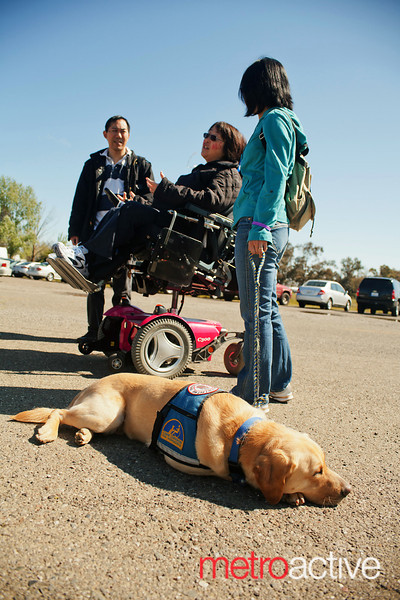 With decreasing ability to complete activities of daily living like feeding or dressing herself, Kameda has become dependent upon a number of pieces of medical equipment, support from family and caregivers, and the assistance of guide dog Galvin, who can help her with many basic tasks.<br /> <br /> Photo by Jessica Shirley-Donnelly, JRSD Photography