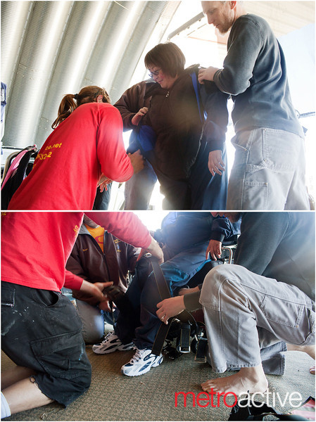 Kameda is helped to her feet and suited up for her jump.<br /> <br /> Photo by Jessica Shirley-Donnelly, JRSD Photography