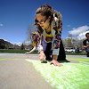 0422CHALK.jpg Laura Demonico (cq), 17, looks for where she is going to add her next continent in the chalk drawing of the earth she is doing with several other students to silently counter protest the Westboro Baptist Church people who are planning a protest at Boulder High School in Boulder, Colorado April 22, 2010.  CAMERA/Mark Leffingwell