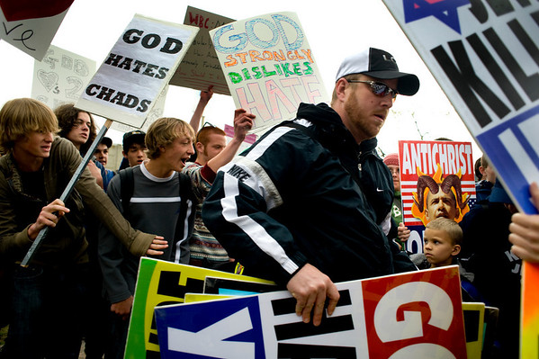 Steve Drain, of Westboro Baptist Church in Kansas, leaves after protesting in front of Boulder High School in Boulder, Thursday, April 22, 2010.