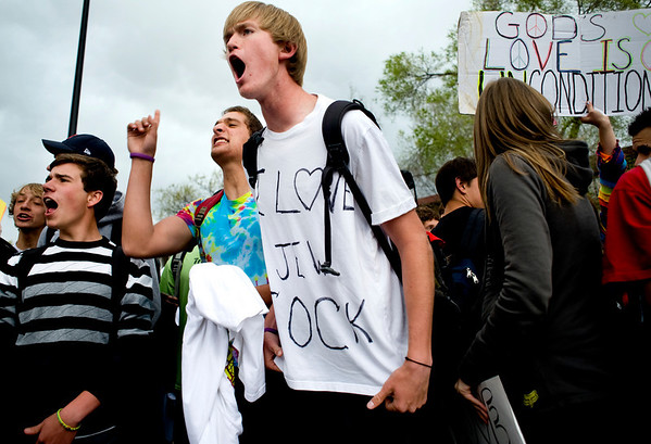 Boulder High senior Walter Bertini yells as the car of the Westboro Baptist Church protesters leave the front of Boulder High School in Boulder, Thursday, April 22, 2010.
