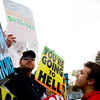 Boulder High senior Otto Mehidic tires to get a reaction out of Steve Drain, of Westboro Baptist Church in Kansas, as he protests in front of Boulder High School in Boulder, Thursday, April 22, 2010.