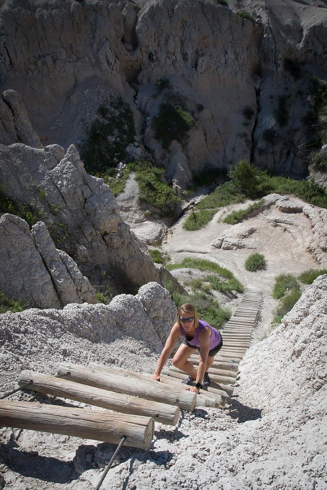 Gretchen climbing a ladder