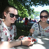 Annual Strawberrie 'n' Arts Festival on Westford Town Common. Miriam Jones, left, and her sister Emma Jones, both of Warwick, R.I. share strawberries and cream. (SUN/Julia Malakie)