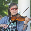 Contra dance band Oh, CONTRAire!, including Judy Wong on fiddle, performs at annual Strawberrie 'n' Arts Festival on Westford Town Common. (SUN/Julia Malakie)