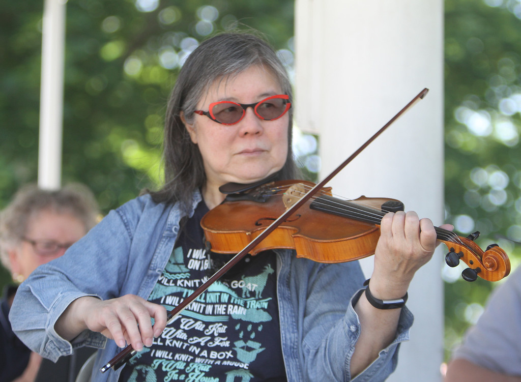 . Contra dance band Oh, CONTRAire!, including Judy Wong on fiddle, performs at annual Strawberrie \'n\' Arts Festival on Westford Town Common. (SUN/Julia Malakie)