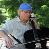 Contra dance band Oh, CONTRAire!, including Bill Denison on cello, performs at annual Strawberrie 'n' Arts Festival on Westford Town Common. (SUN/Julia Malakie)
