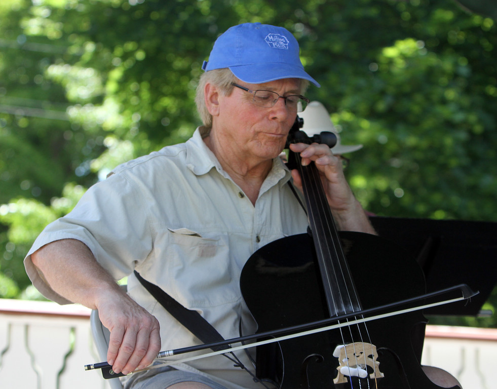 . Contra dance band Oh, CONTRAire!, including Bill Denison on cello, performs at annual Strawberrie \'n\' Arts Festival on Westford Town Common. (SUN/Julia Malakie)