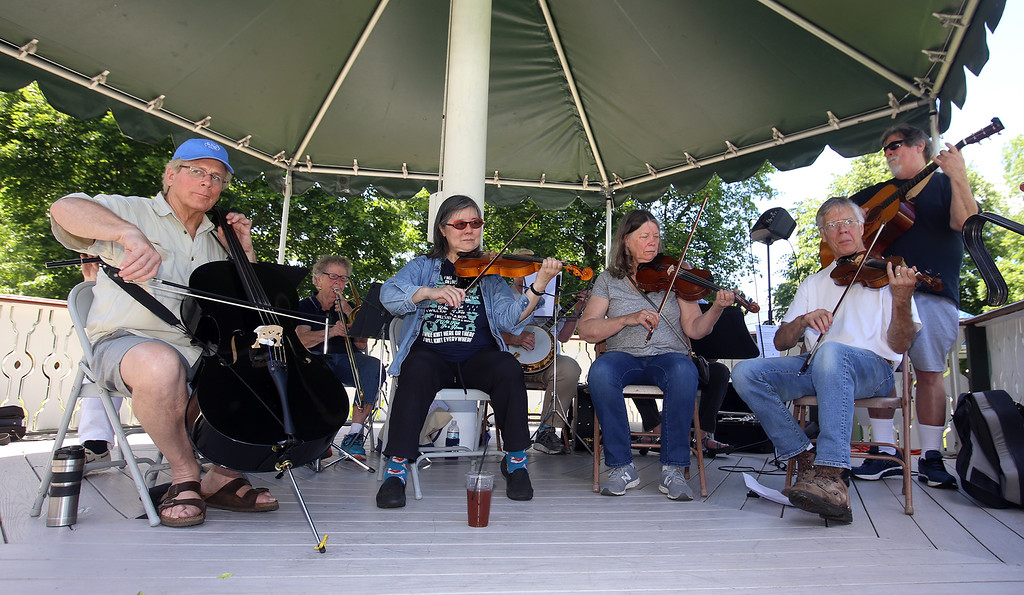 . Contra dance band Oh, CONTRAire! performs at annual Strawberrie \'n\' Arts Festival on Westford Town Common. (SUN/Julia Malakie)