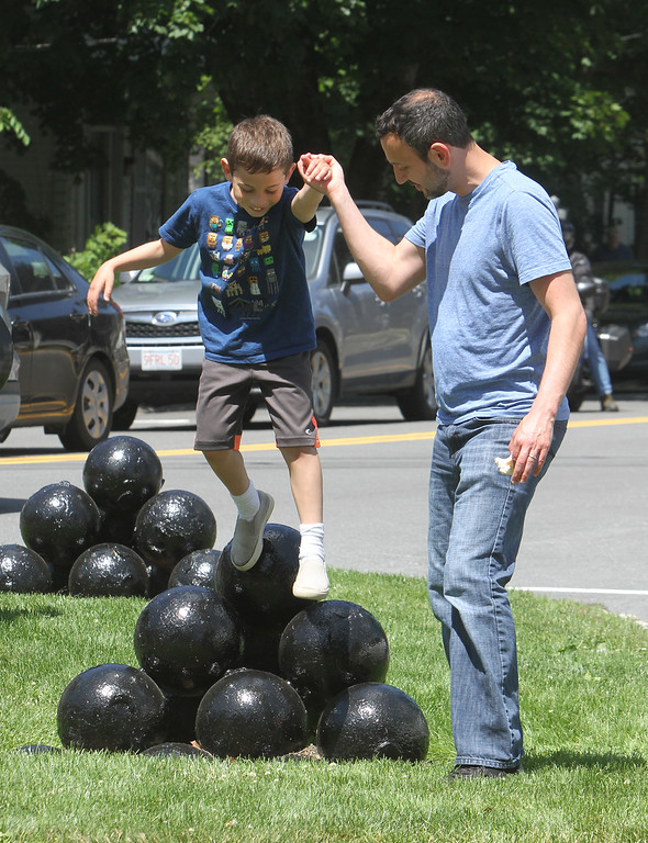 . Annual Strawberrie \'n\' Arts Festival on Westford Town Common. Todd Rovner of Lexington with son Adam Rovner, 7, jumping off the cannonballs on Town Common. (SUN/Julia Malakie)