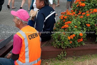 "Whangamata Beach Hop 2012. ""CREW"" member sits watching the passing parade."