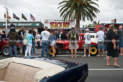 "Whangamata Beach Hop 2012.PArade and crowd under ""Beach Hop"" sign."