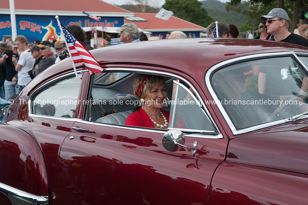 Whangamata Beach Hop 2012. Woman in vintage red car.