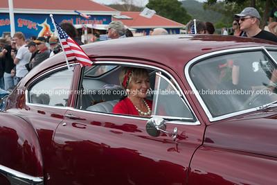 Whangamata Beach Hop 2012. Woman in vintage red car.